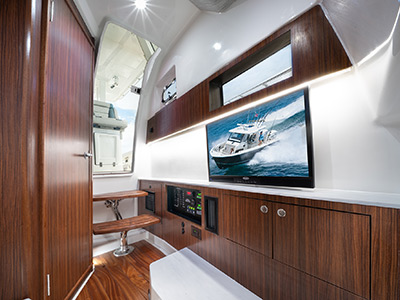 Interior photo of the Pursuit S 358 Sport Center Console boat with cabin for overnighting.