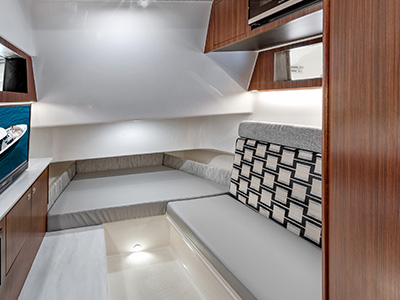 Interior photo of the Pursuit S 358 Sport Center Console boat's cabin with a V berth.