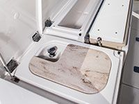 Bait prep station: sink with corian cutting board, pull-out fresh water sprayer and sliding tackle drawers