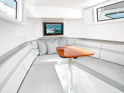 Detail of S 378 luxury berth with teak table.