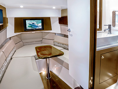 Pursuit S 378 Sport boat cabin forward seating with table.