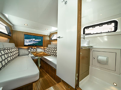A shot of the cabin with enclosed head on the S 428 Pursuit Sport Center Console Boat.