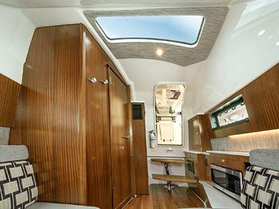 A shot of the luxurious cabin on the S 428 Pursuit Sport Center Console Boat.