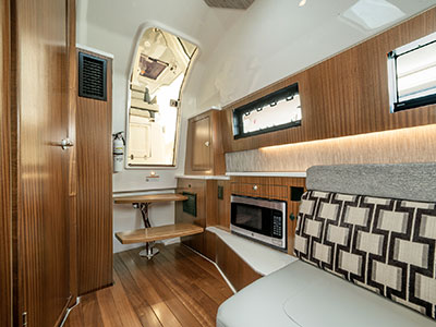 A shot of the luxurious cabin and side window on the S 428 Pursuit Sport Center Console Boat.