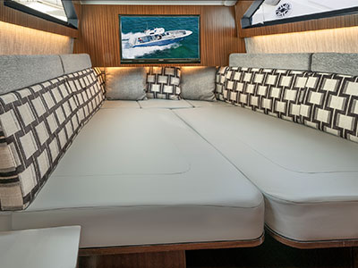 A shot of the luxurious cabin transformed into a berth for overnighting on the S 428 Pursuit Sport Center Console Boat.