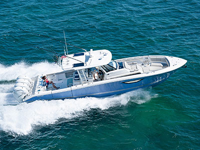 Aerial profile view of Gulf Stream Blue S 428 Sport center console running right with quad Yamaha outboard engines.