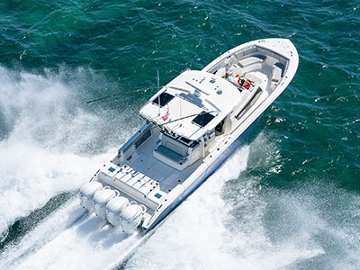 Aerial overhead rear view of Gulf Stream Blue S 428 running right with quad Yamaha outboard engines and oversized hartop.