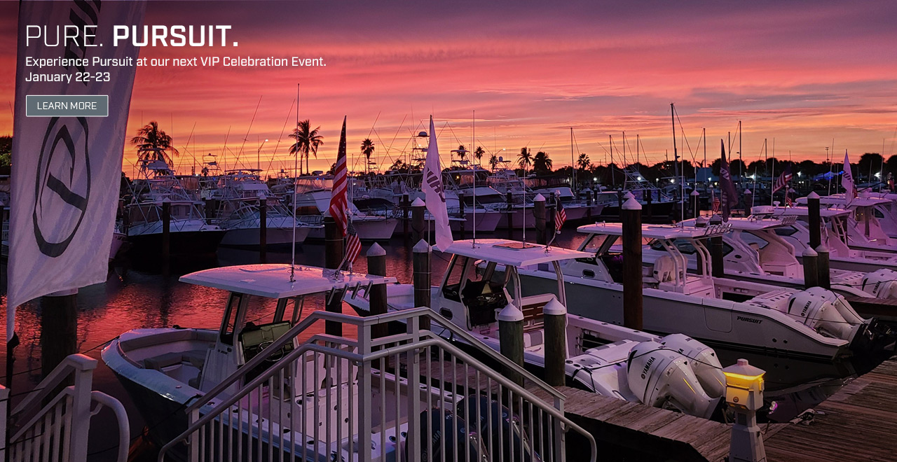 Aerial sunset photo of Pursuit Boats at doc. Text over photo. PURE. PURSUIT. Experience Pursuit at our next VIP Celebration Event. January 22-23. Learn More.