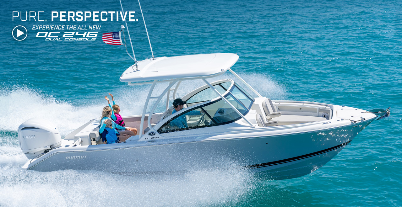 A starboard side exterior view of family fun on a DC 246 Pursuit Dual Console Boat running offshore. Text over graphic. PURE. PERSPECTIVE. Experience the all new DC 246 Dual Console.