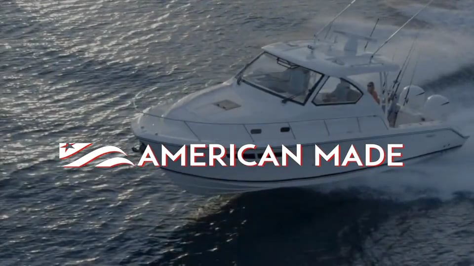 Pursuit running shot with American Made text over graphic.