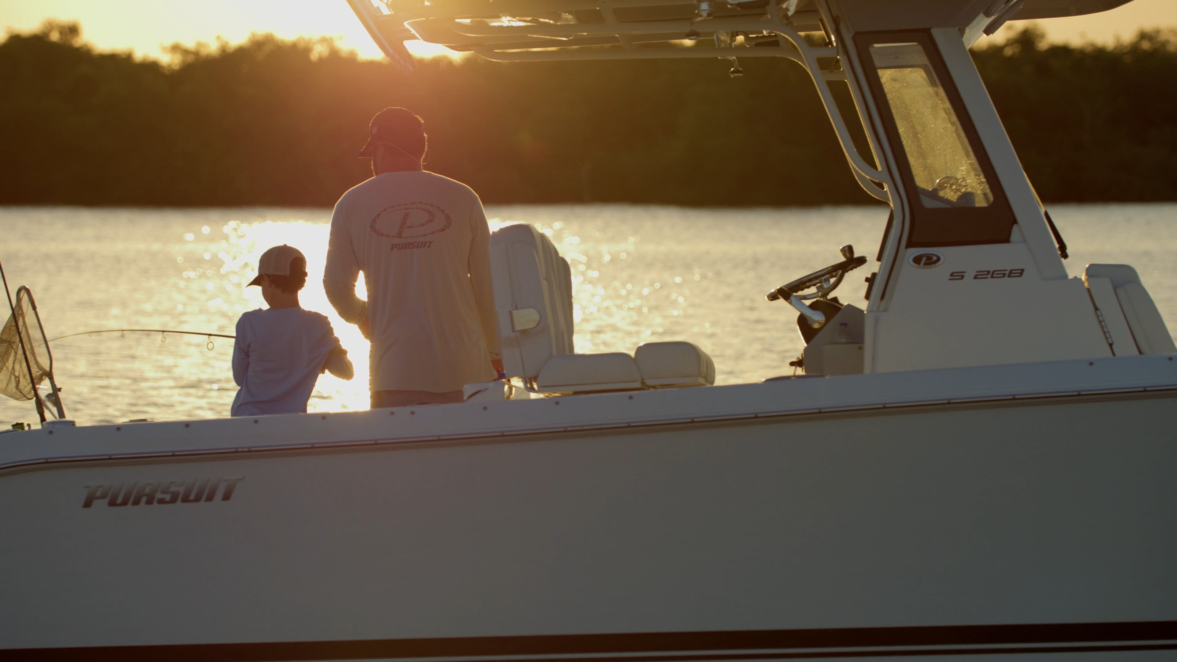 Father and son fishing at sun rise.