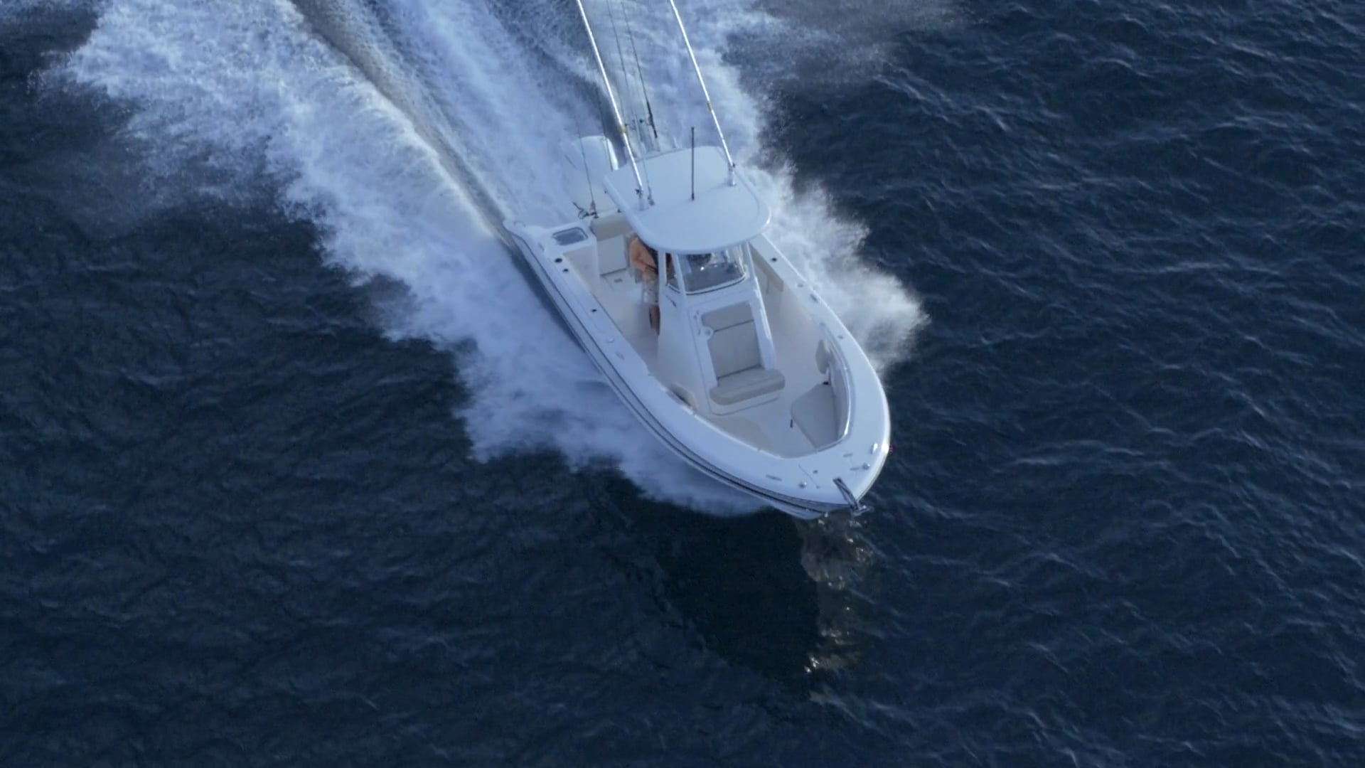 Aerial front view of white C 238 center console boat.