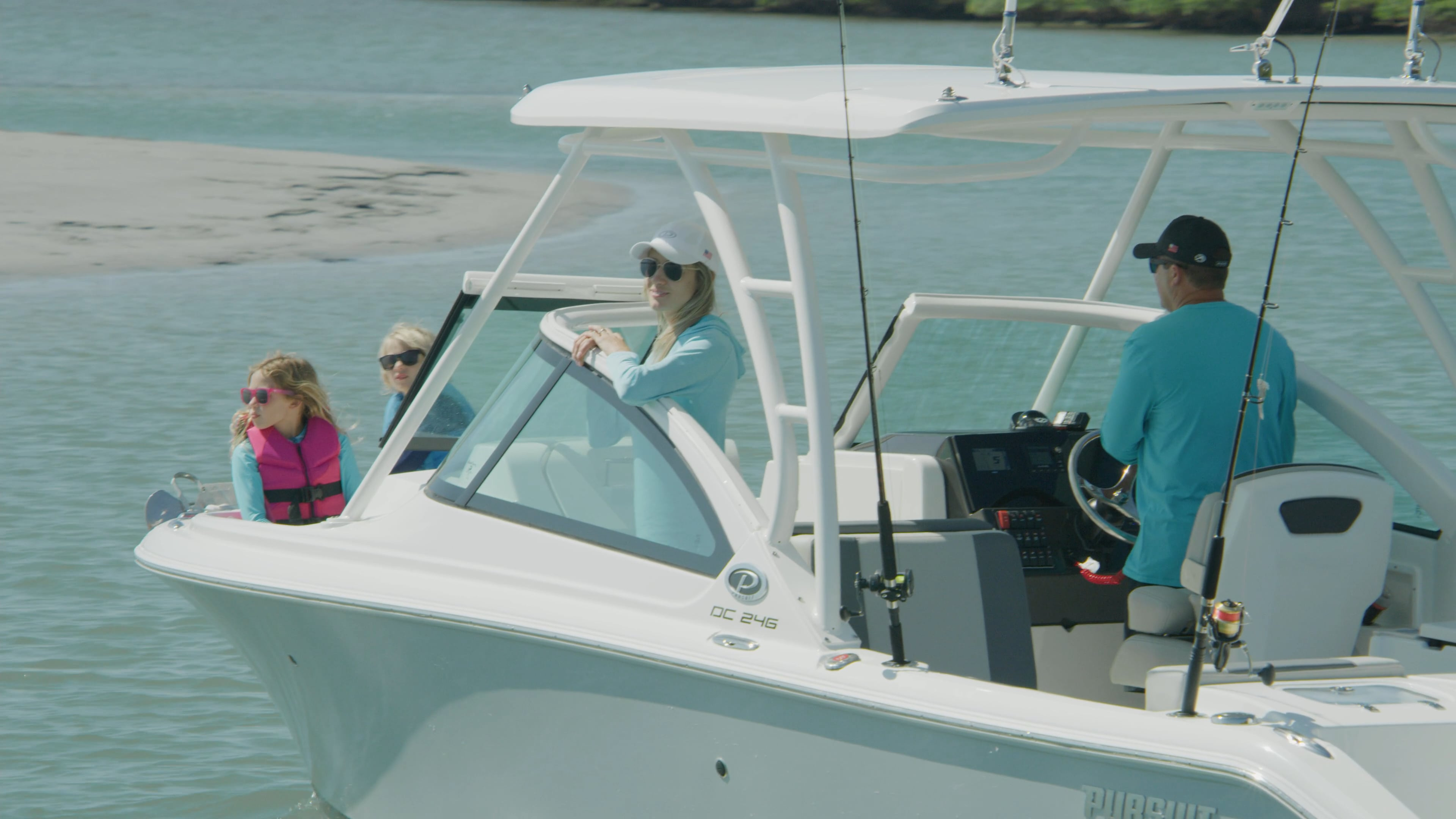 A family relax on 25' DC 246 Pursuit dual console boat.