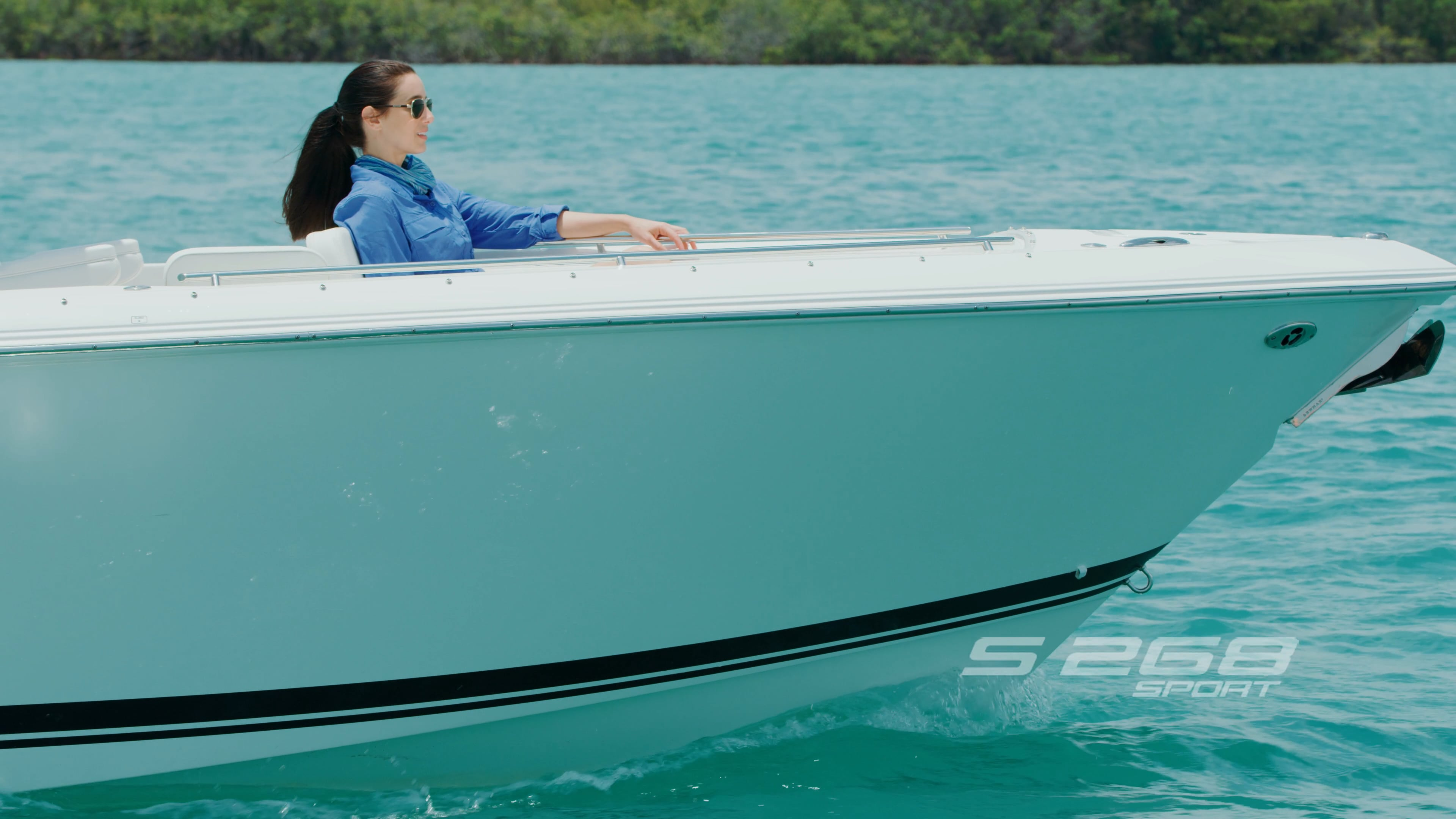 Detail profile view of S 268 Sport Boat with woman seated in bow seating area.