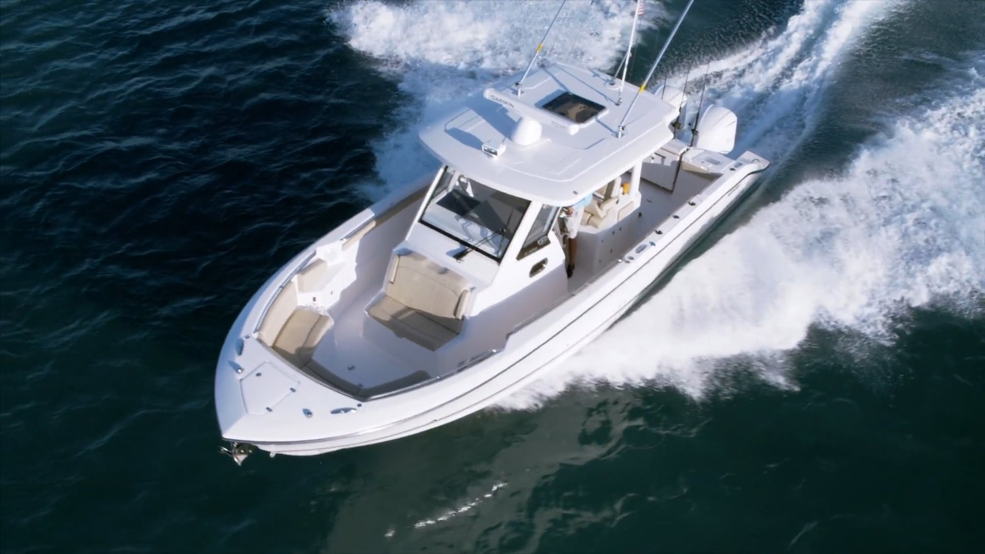 Aerial one quarter front view of S 328 Sport boat running to left.