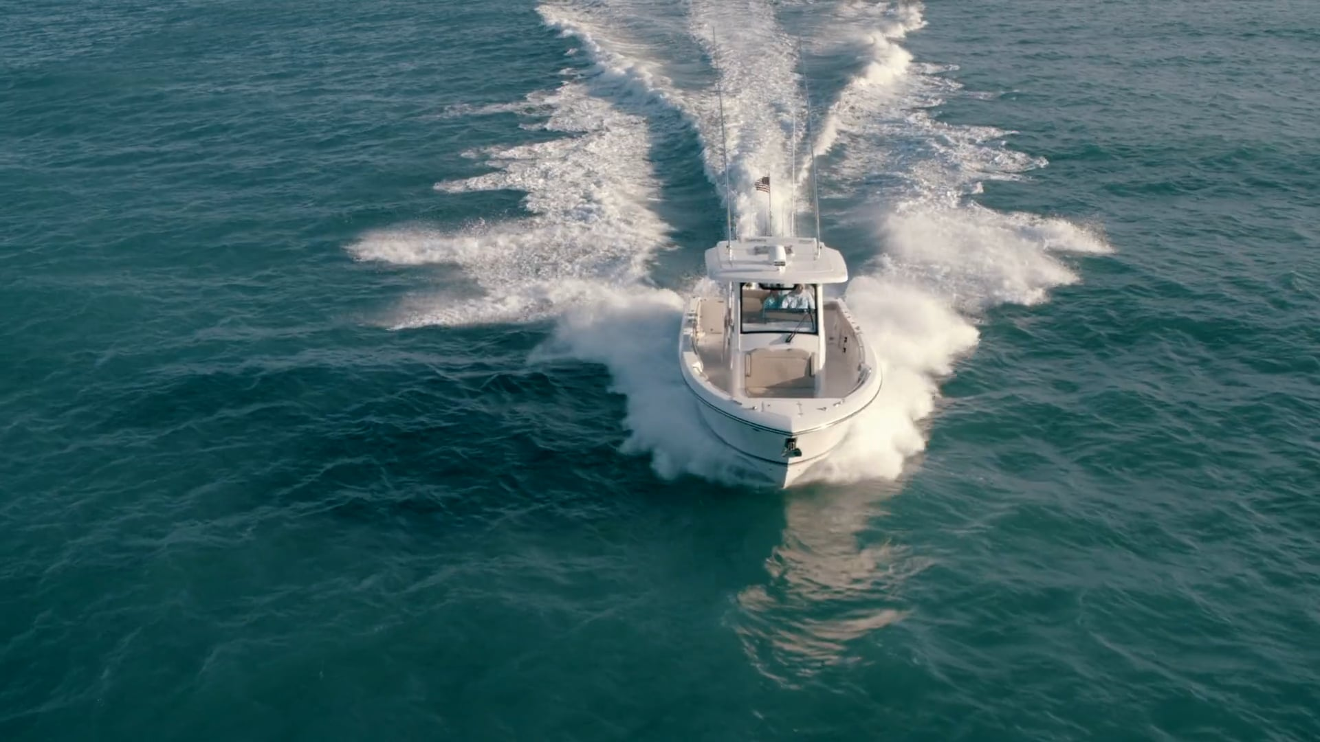 Aerial front view of white S 328 Sport boat running with glass windshield.