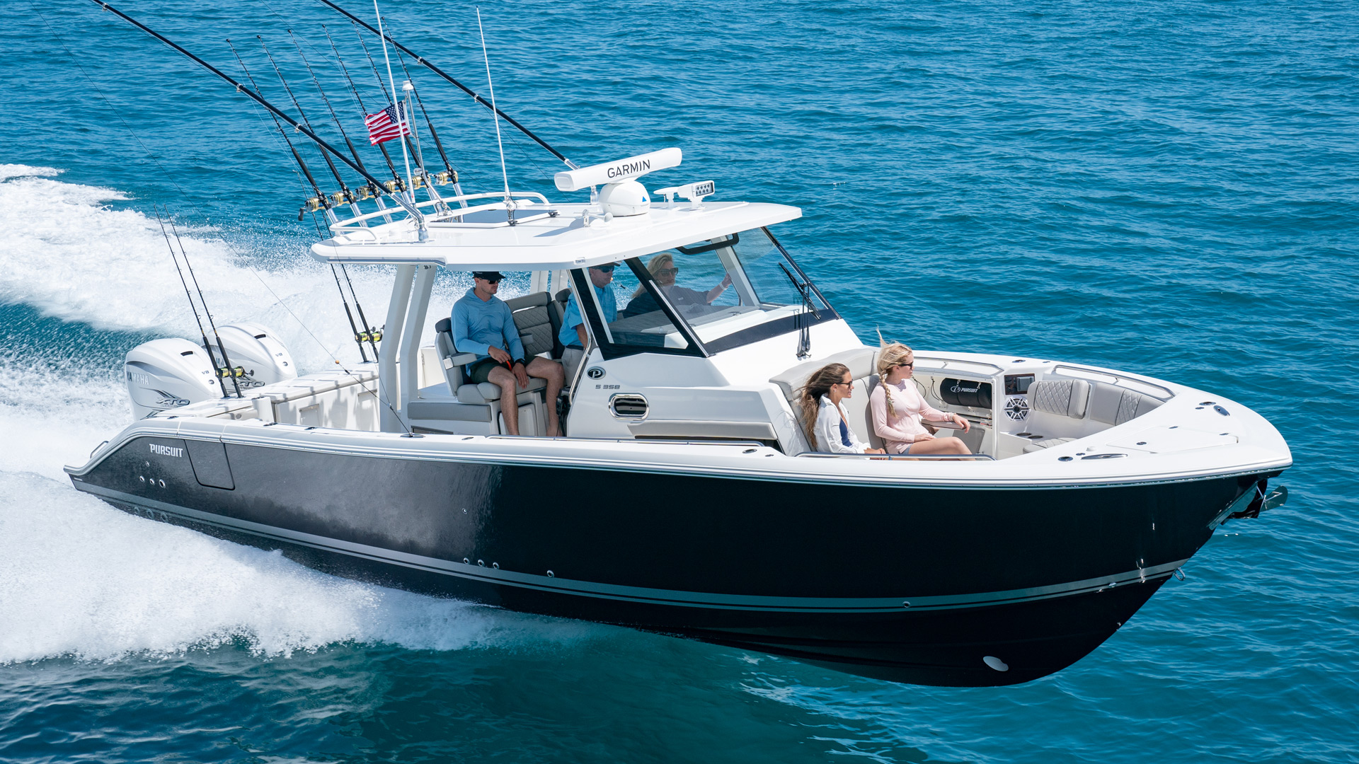Aerial profile of S 358 Center Console Sport Boat running right offshore.