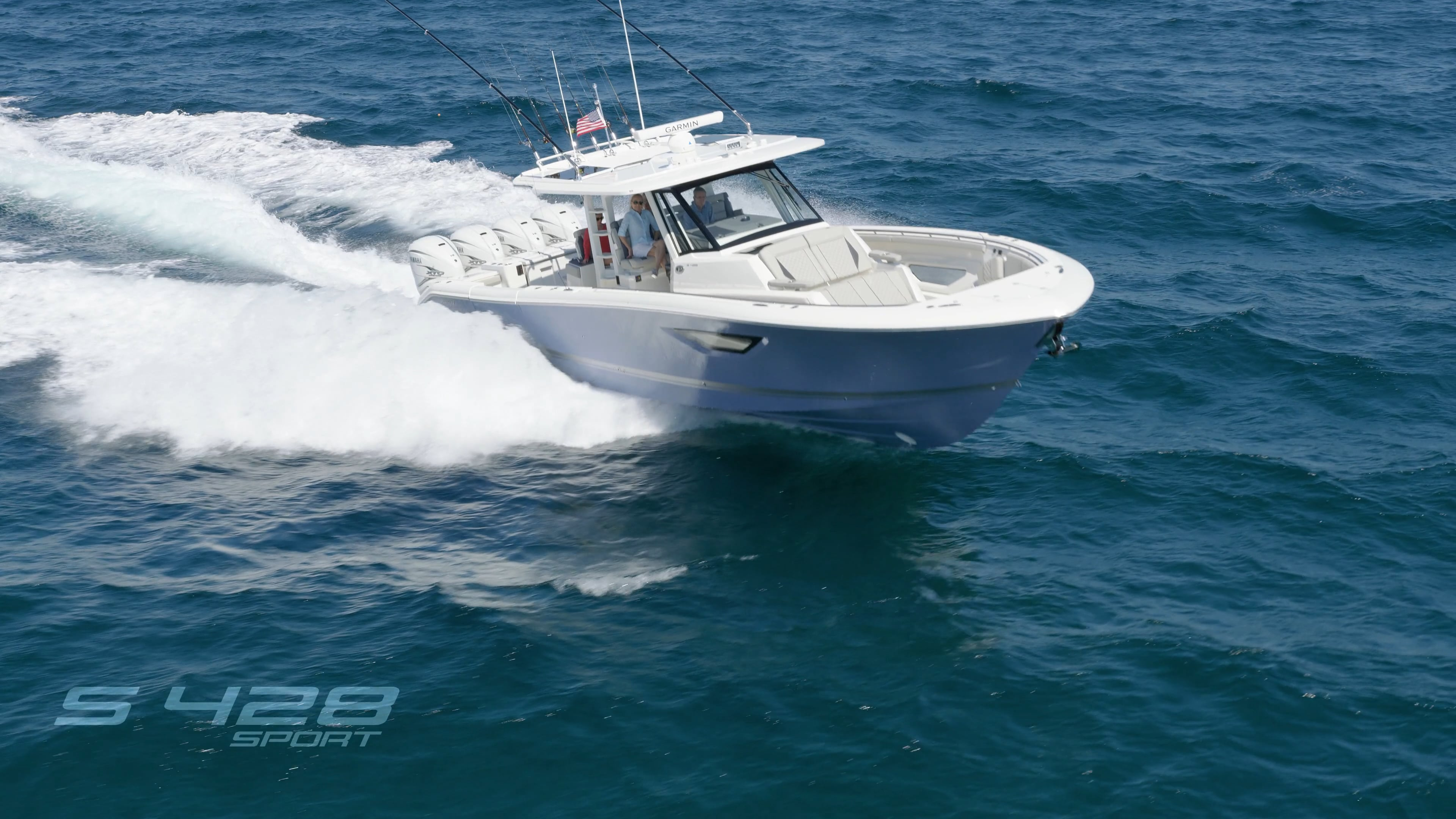 Aerial front one quarter view of Gulf Stream Blue S 428 Flagship Sport boat running right