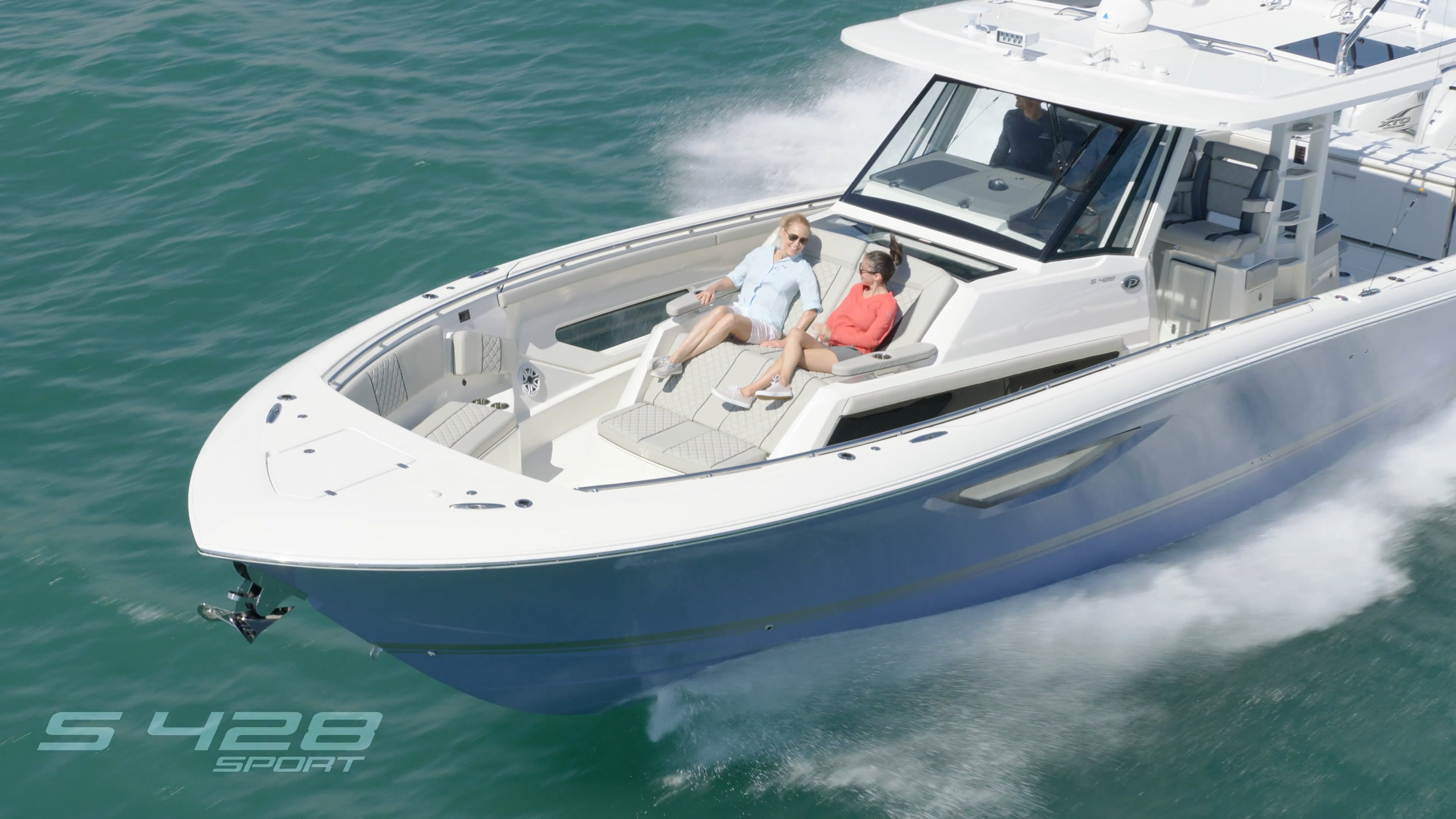 Aerial front one quarter view of Gulf Stream Blue S 428 Flagship Sport boat running left.