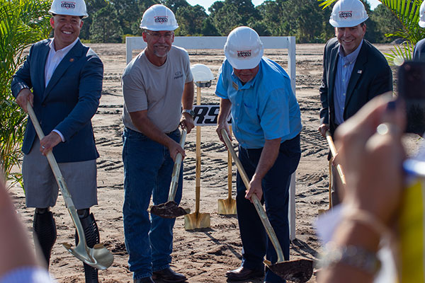 Close up of first breaking ground for new manufacturing facilities