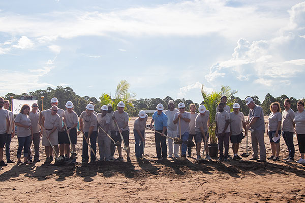 Group shot of first breaking ground for new manufacturing facilities