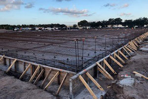 Pursuits new expansion site with rebar down for pouring concrete.