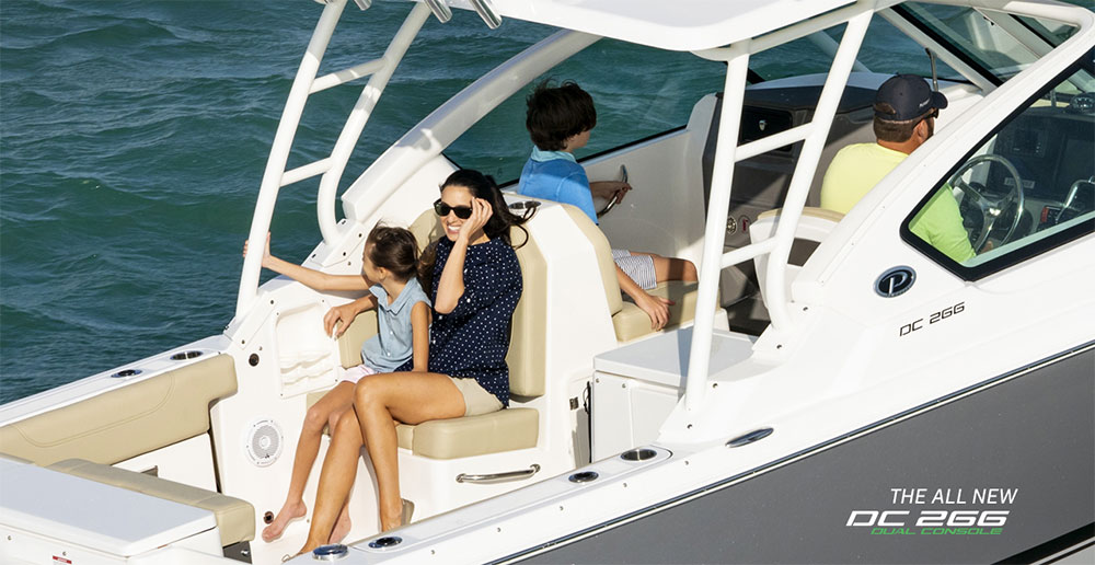 Starboard side shot of family on titanium Pursuit DC 266