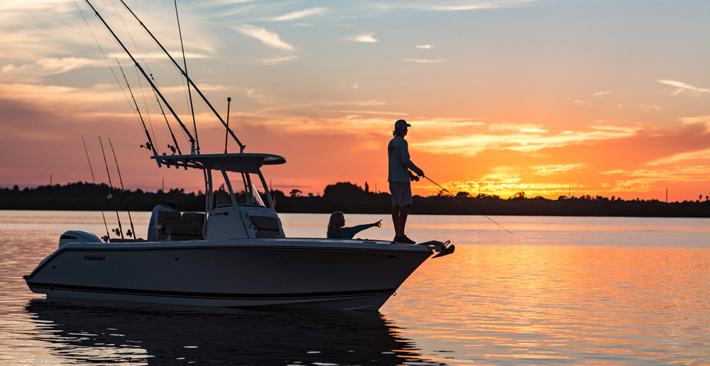 Sunset shot of C 238 with fisherman on the bow