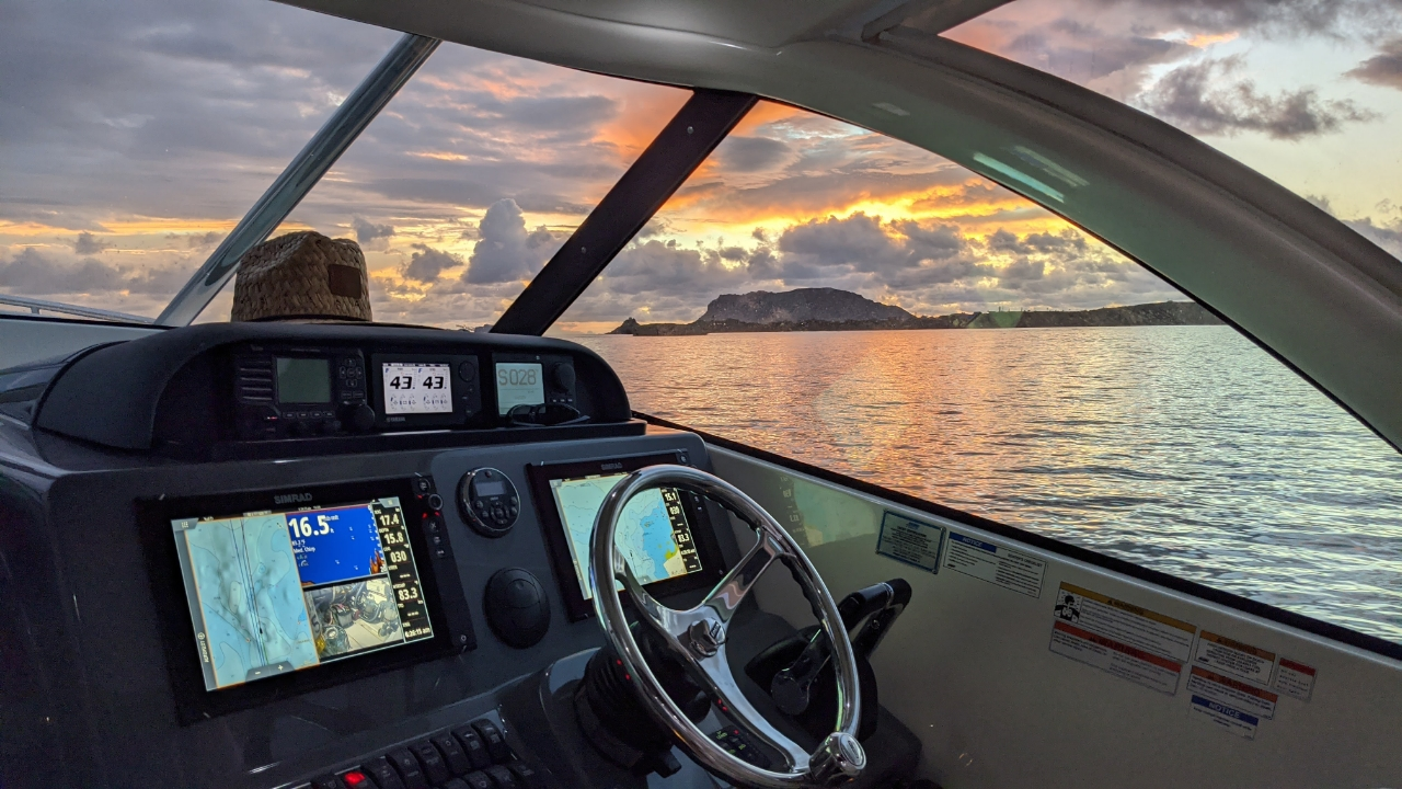 Sunrise through helm side window on a Pursuit Offshore boat