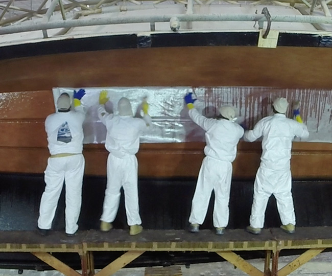 Pursuit workers show in the lamination building process of a Pursuit Hull.
