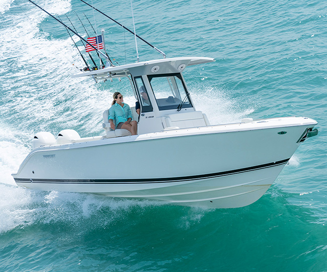 Profile view of white S 268 Sport boat cruising right with fishing rods.