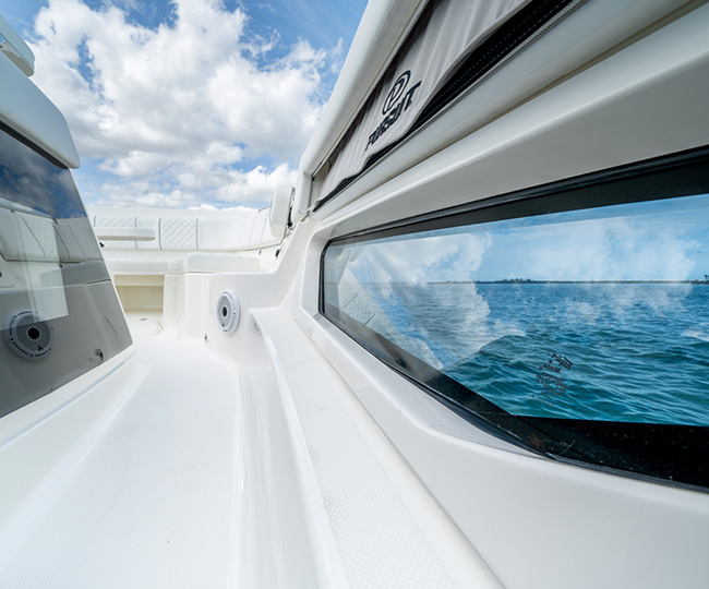 Detail view of port side hull window of S 428 Sport boat.